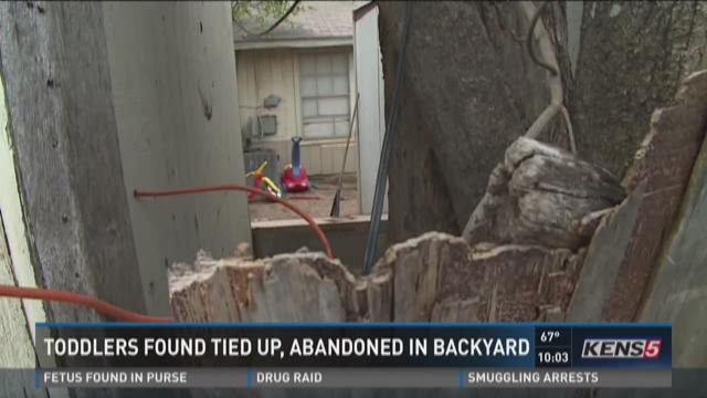 Toddlers found tied up, abandoned in back yard