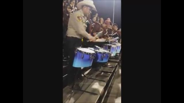 Sheriff's deputy drums with HS band